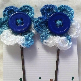 bobby-pins with hand crocheted flowers