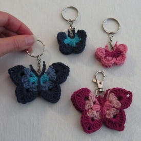 Colorful butterfly keychain. Size large.