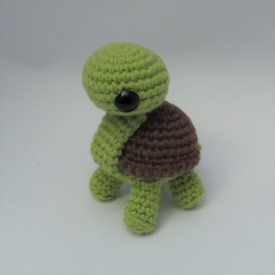 Amigurumi turtle, cute crochet animal.
