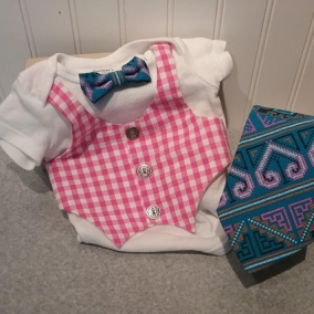 Pink plaid vest onesie with blue and pink bow tie and option of adding matching adult bow tie
