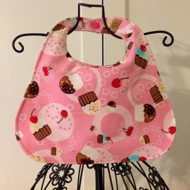 Reversible soak proof cupcake and candy stripe bib